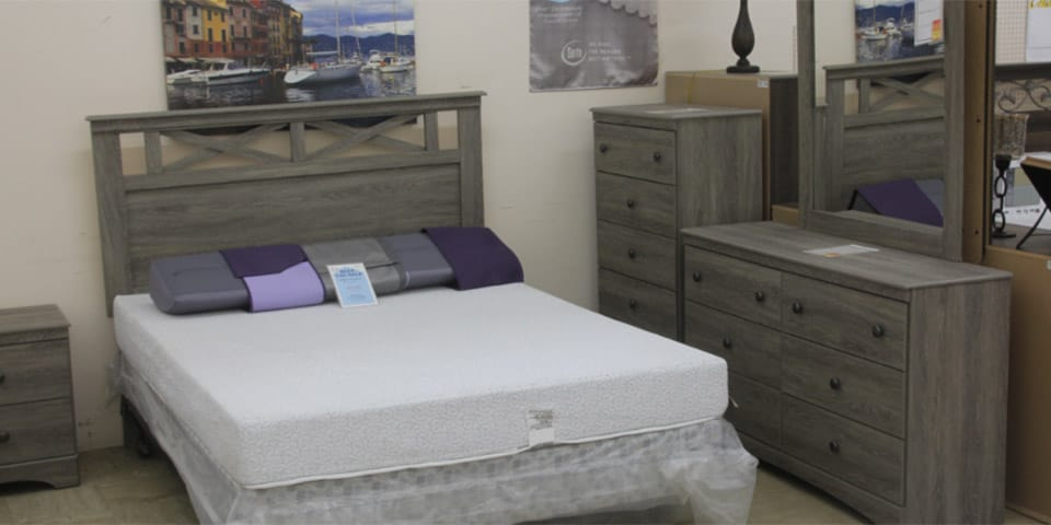 Bedroom set with attractive weathered driftwood finish, dressers, nightstand and premium mattress.