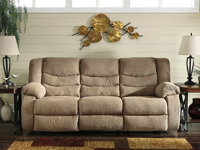An Ashley sofa, with endtables and decor pieces
